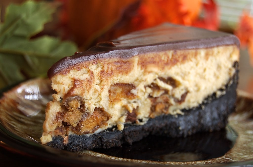 Peanut butter and chocolate fans will enjoy devouring this Peanut Butter Cup Cheesecake. - Bake or Break