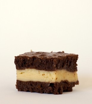Rich brownies surround a sweet layer of cream cheese flavored with Irish Cream in these Irish Cream Brownies! - Bake or Break