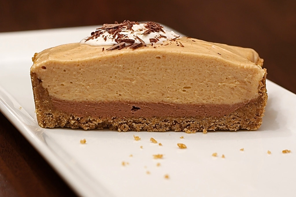 This simple Peanut Butter Tart is a deliciously sweet and rich no-bake dessert with a little chocolate surprise inside!