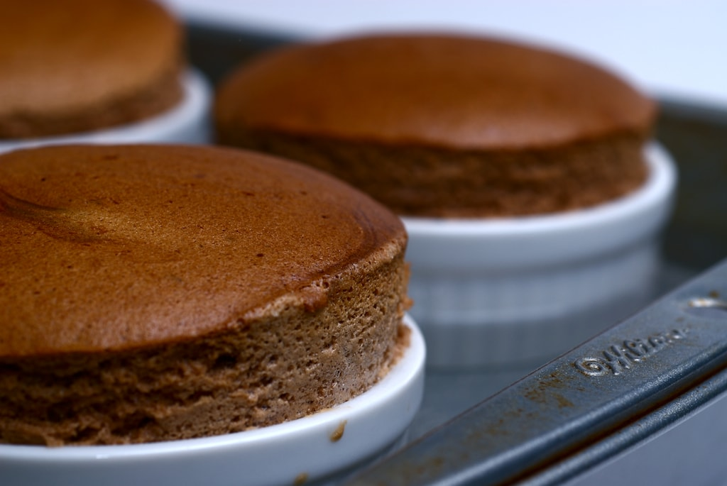 There's a chocolate-hazelnut surprise inside these Giandua Souffles. - Bake or Break