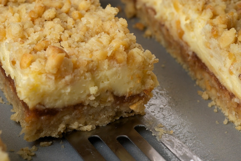 Cream Cheese and Oat Bars are all about the layers with an oat crust, apple butter, and sweet cream cheese.