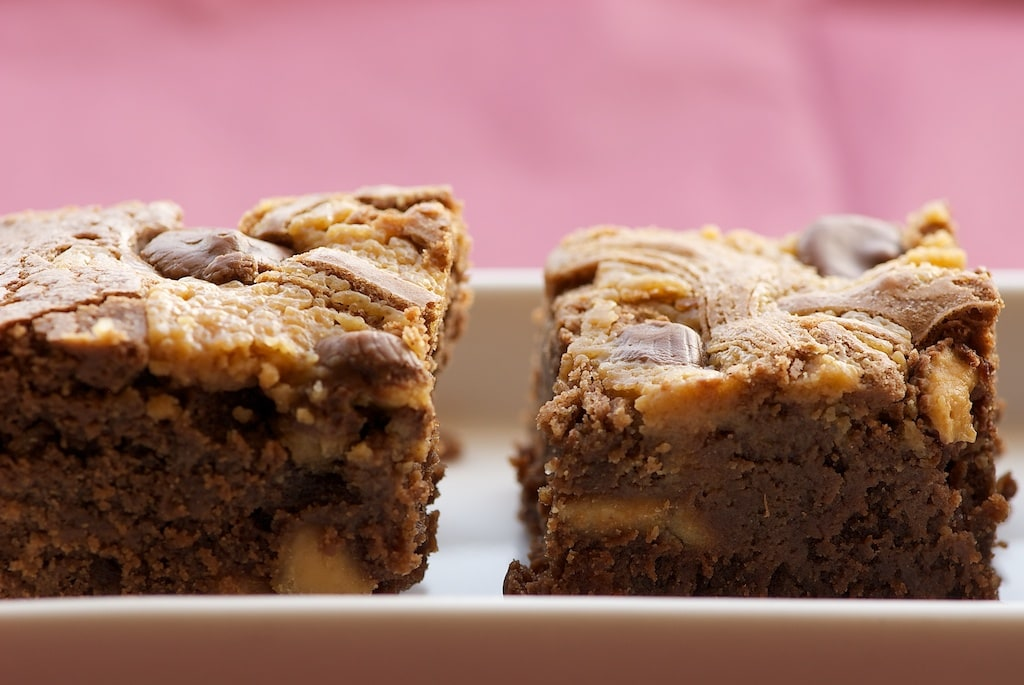 Peanut Butter Brownies are rich brownies swirled with peanut butter and dotted with mini peanut butter cups. Absolutely delicious! - Bake or Break
