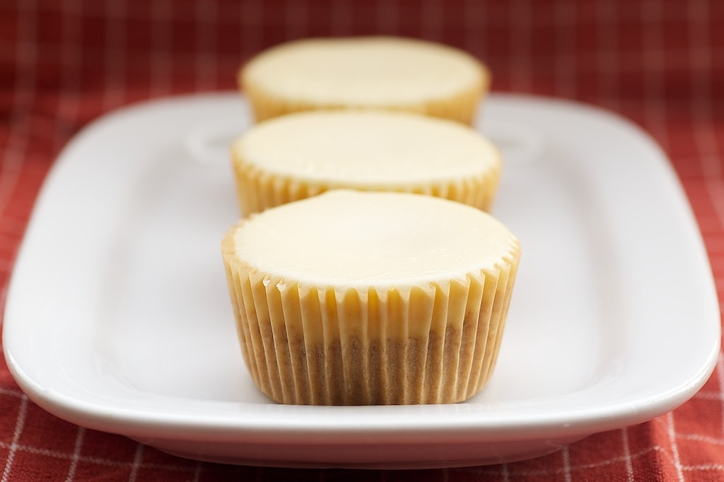 Peanut Butter Cheesecake Minis feature a peanut butter cup surprise inside miniature cheesecakes.