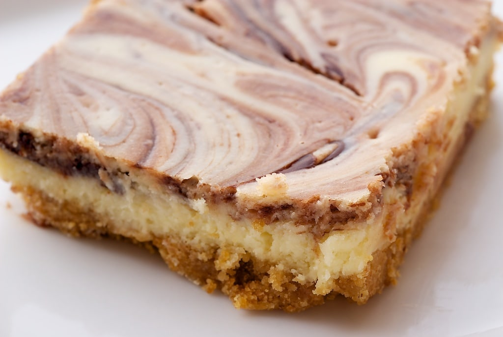 Nutella Swirl Cheesecake Bars feature a swirl of that favorite chocolate-hazelnut spread in sweet, rich cheesecake bars. - Bake or Break