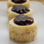 Vanilla Bean Mini Cheesecakes with Blueberry Sauce