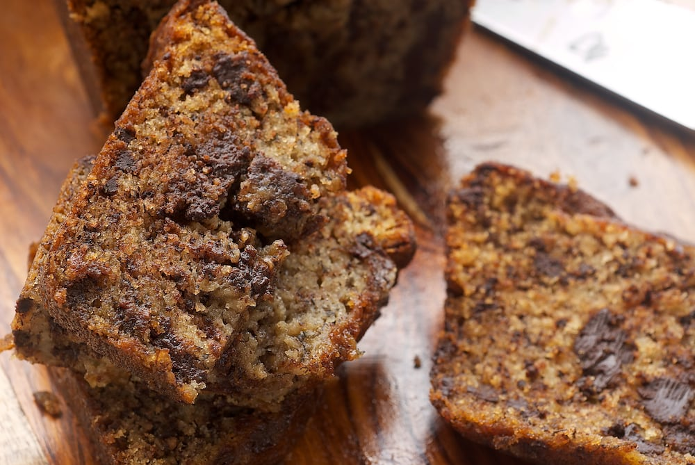 Add a little dark chocolate to your next banana bread with Chocolate Chunk Banana Bread. - Bake or Break