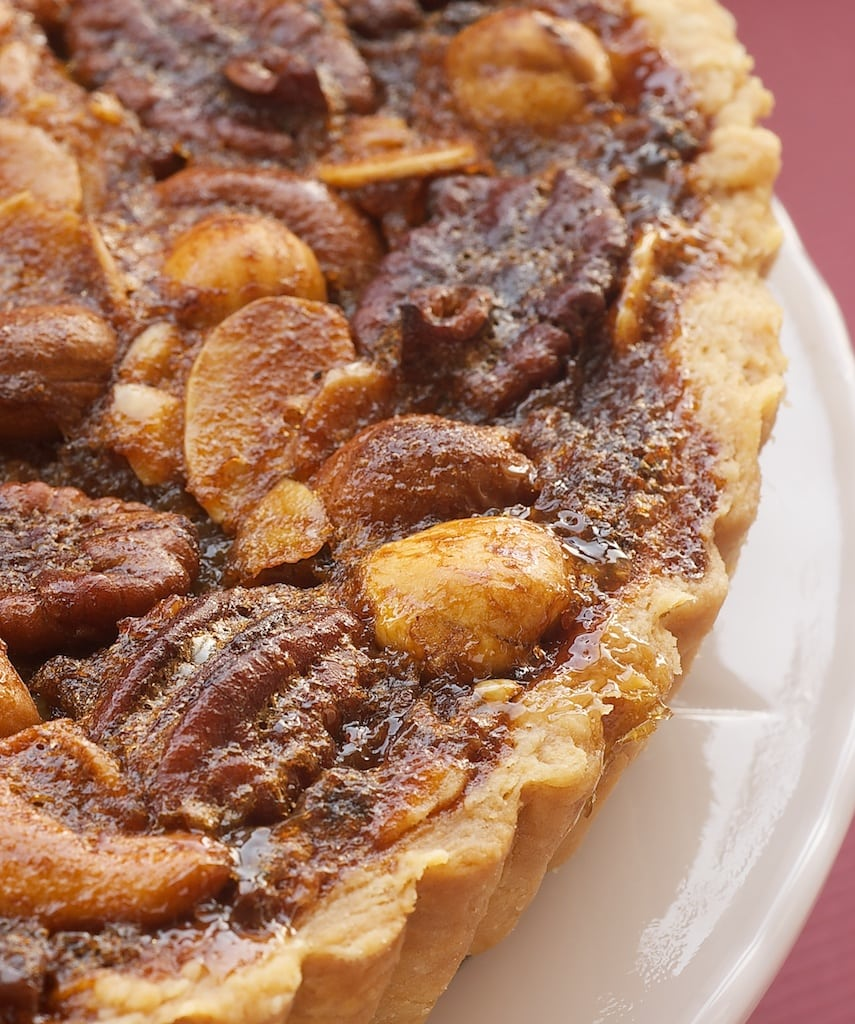 Change up your pecan pie game with this wonderfully delicious Mixed Nut Tart. - Bake or Break