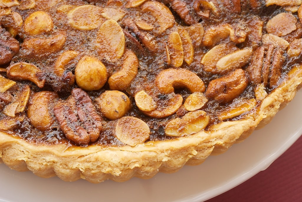 Mixed Nut Tart is perfectly sweet, gooey, and nutty! - Bake or Break