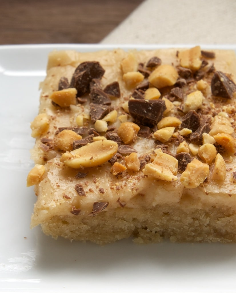 Peanut Butter Texas Sheet Cake is a must-bake dessert for peanut butter fans. Great for feeding a crowd! - Bake or Break