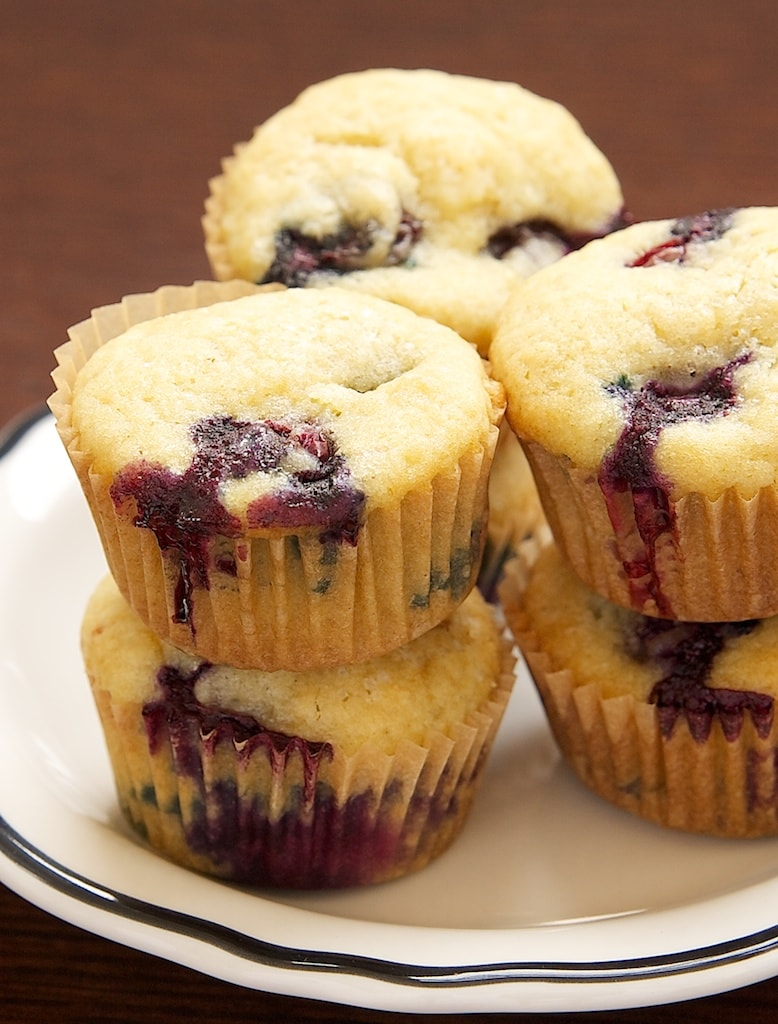 Blueberry Sour Cream Mini Muffins have plenty of fresh blueberries along with a hint of lemon. They are just the thing for a special breakfast treat! - Bake or Break