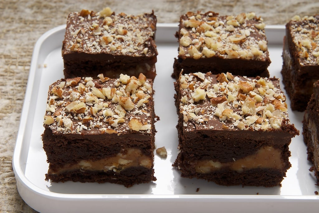 Caramel Pecan Brownies feature layers of rich brownies, nutty caramel, even more chocolate, and crunchy pecans. Delicious!