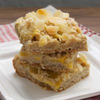 Fresh peaches, crunchy almonds, and a buttery crust make these Peach Crumble Bars irresistible!