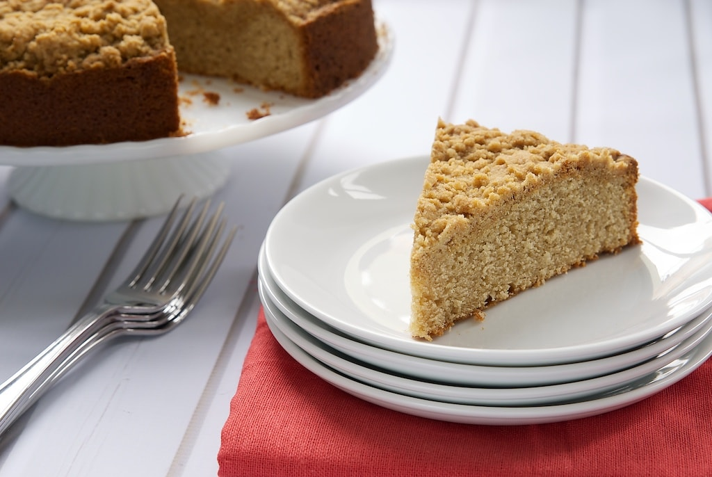 This Brown Butter Sour Cream Crumb Cake combines delicate cake, brown butter, and a crumb topping for a delicious cake to take you from brunch to dessert! - Bake or Break