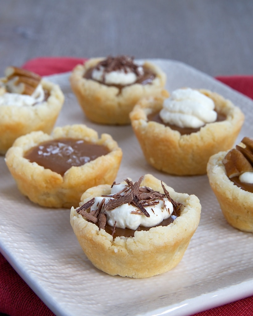 Mini Caramel Tarts combine a cream cheese crust with a rich caramel filling that can be topped with whipped cream, salt, chocolate, or your favorite topping. - Bake or Break