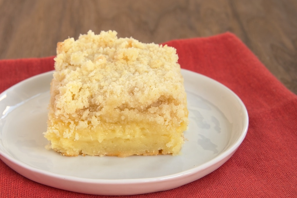 Lemon Yogurt Crumb Cake is a light, moist cake full of lemon flavor. - Bake or Break