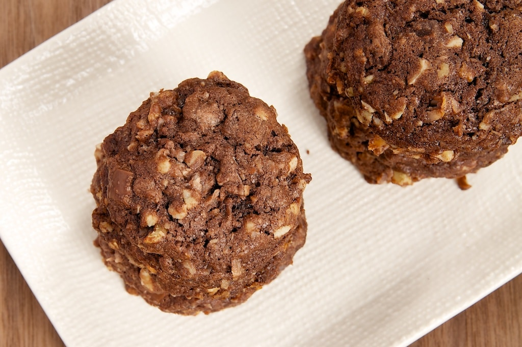 Triple Chocolate Coconut Cookies are big, thick cookies packed with lots of coconut, three kinds of chocolate, and nuts. Delicious!