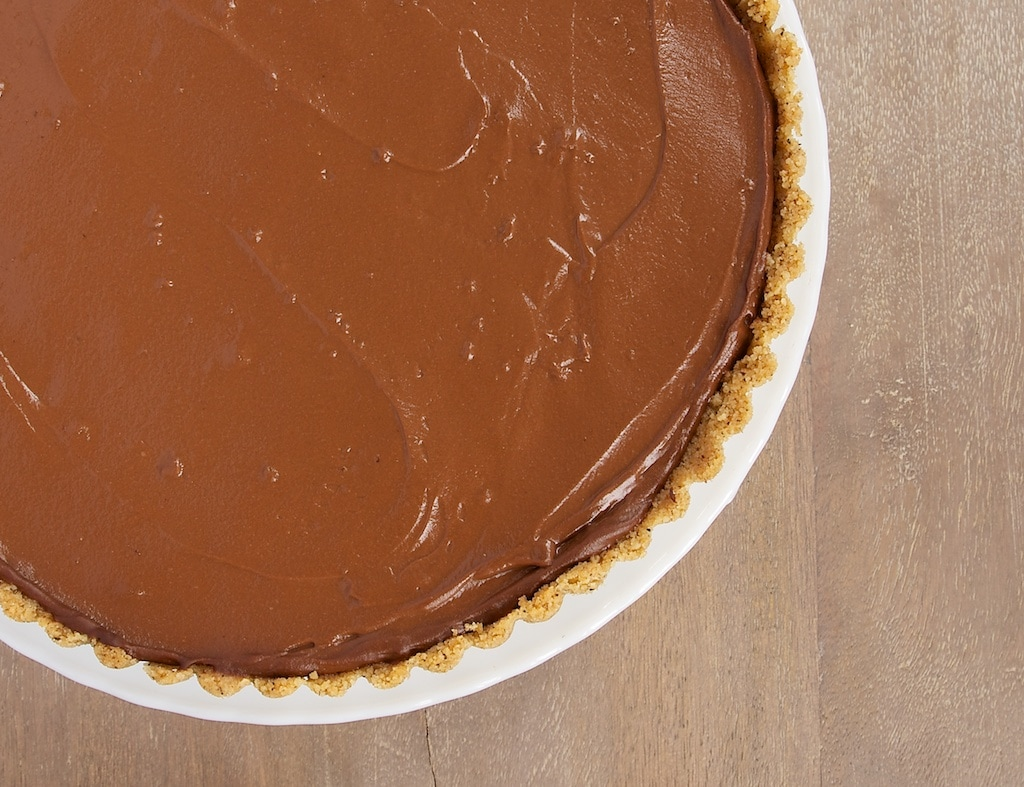 Chocolate Pudding Pie with Peanut Butter Filling is a cool, creamy favorite. Love that little peanut butter surprise inside!