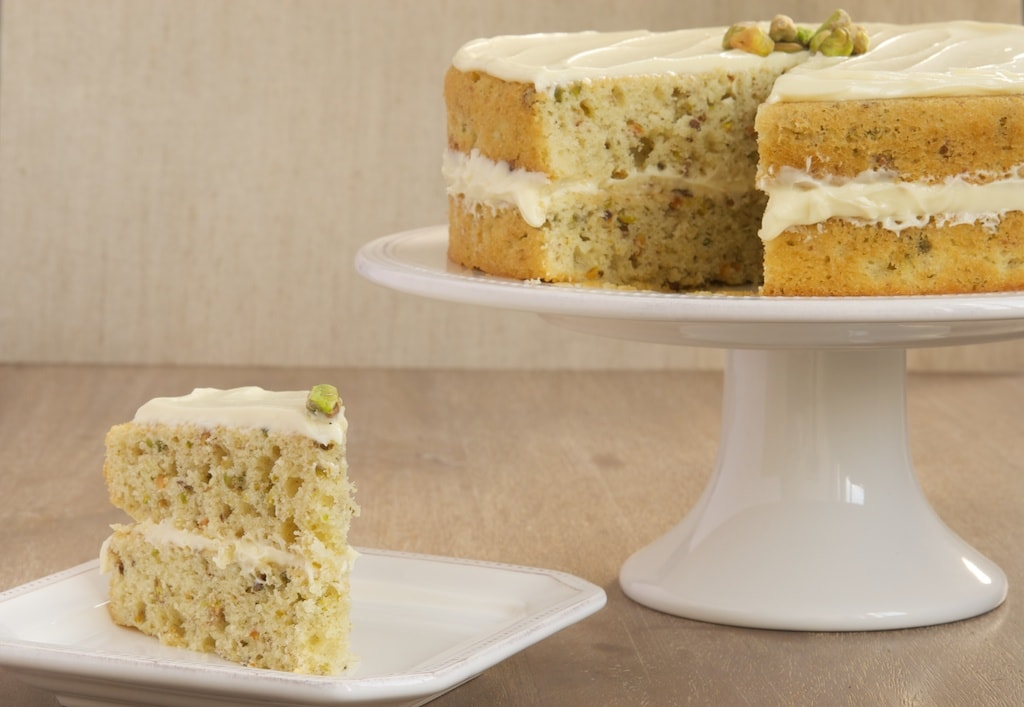 Pistachio Cake with White Chocolate Frosting is sweet, nutty, and wonderfully delicious! - Bake or Break