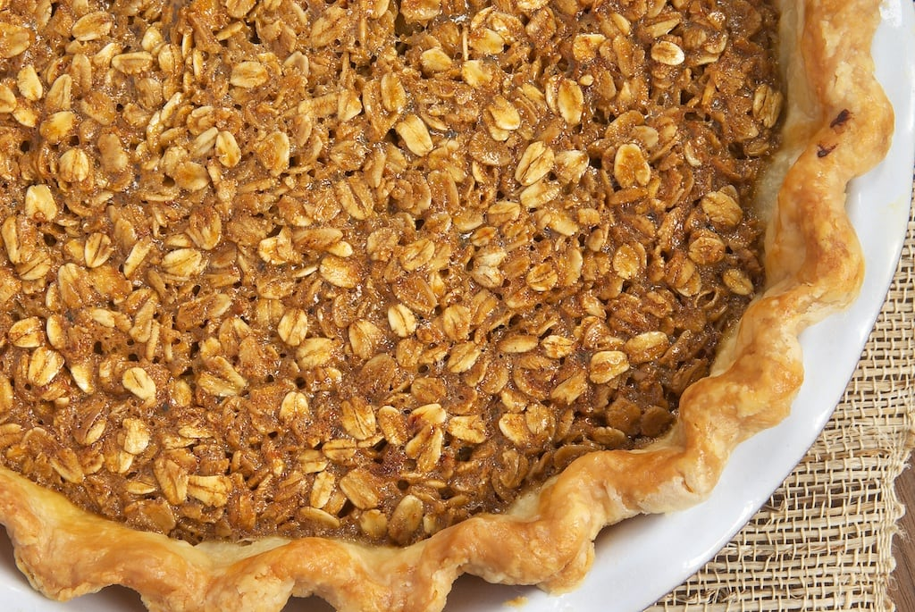 Black Bottom Oatmeal Pie is a wonderfully delicious, warm, gooey pie filled with dark chocolate, brown sugar, and plenty of oats.