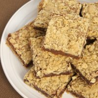 Oatmeal Brownie Bars are a delicious mashup of two favorites - oat bars and brownies. - Bake or Break