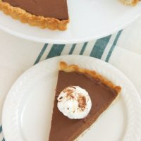 Chocolate Mascarpone Tart is a simple and elegant dessert that features a sweet brown sugar crust and a luscious chocolate filling. - Bake or Break