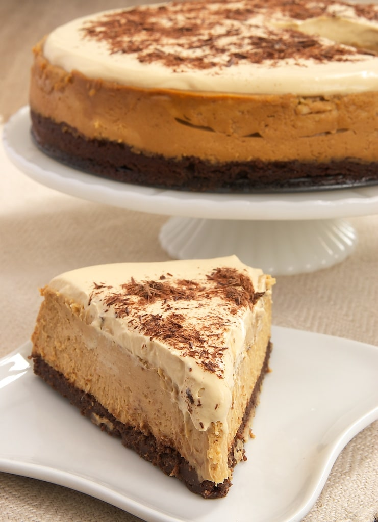 Rich dulce de leche cheesecake sits atop a brownie crust, and it's all topped with whipped cream flavored with even more dulce de leche!