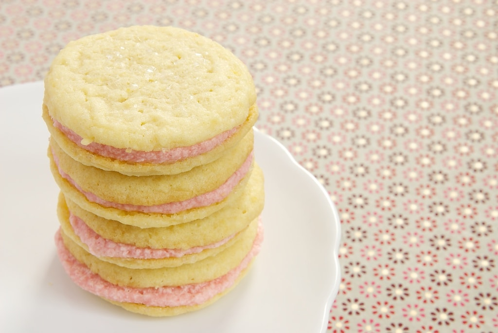 Sweet, tart, soft lemon cookies get sandwiched around a sweet strawberry filling for a lovely summer treat!