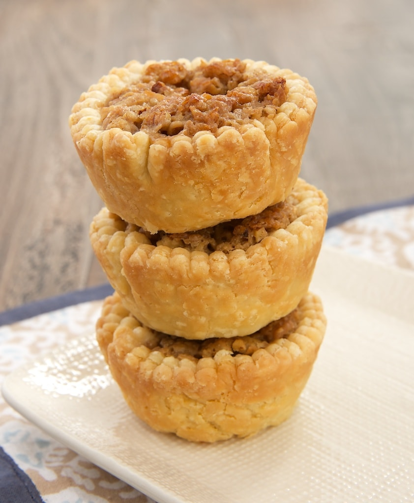 Coconut, crisp rice cereal, and cream cheese provide a delicious twist to pecan pie in these Coconut Pecan Tarts.