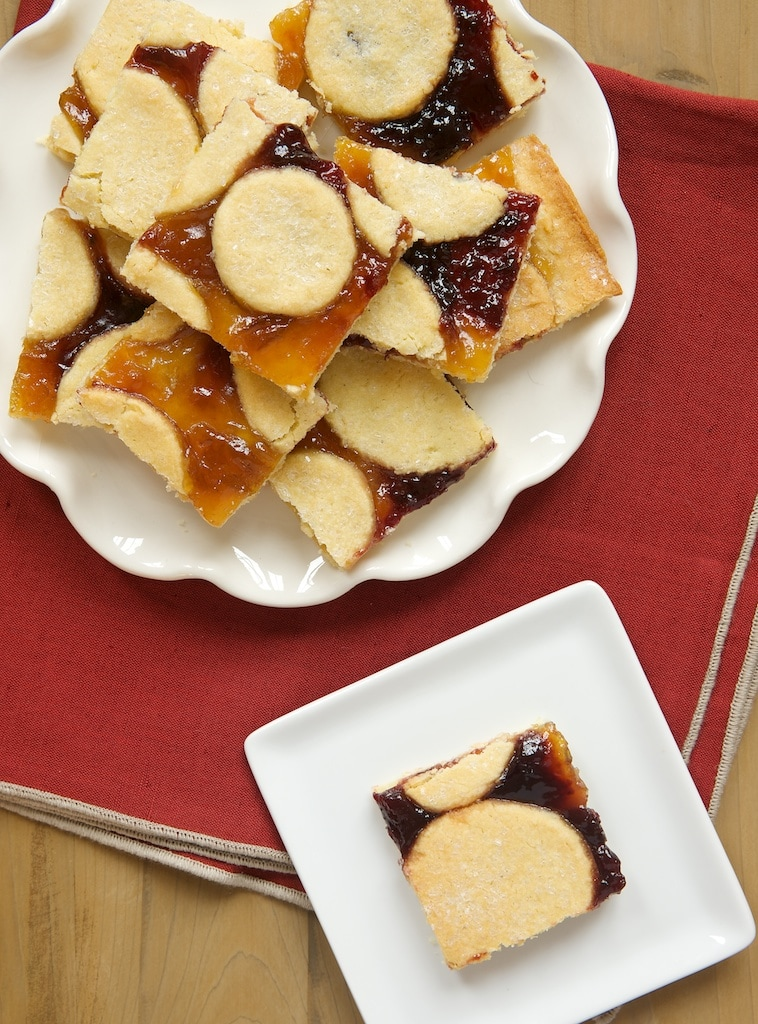 Linzer Bars let you bypass a lot of the rolling and cutting but with the same great flavors as Linzer Cookies!