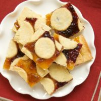Linger Bars combine a sweet sugar cookie crust with your favorite fruit preserves for a delicious, festive treat!