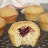 Jam-Filled Doughnut Muffins from Bake or Break have the flavors of a cinnamon-sugar doughnut with a little fruity surprise inside!