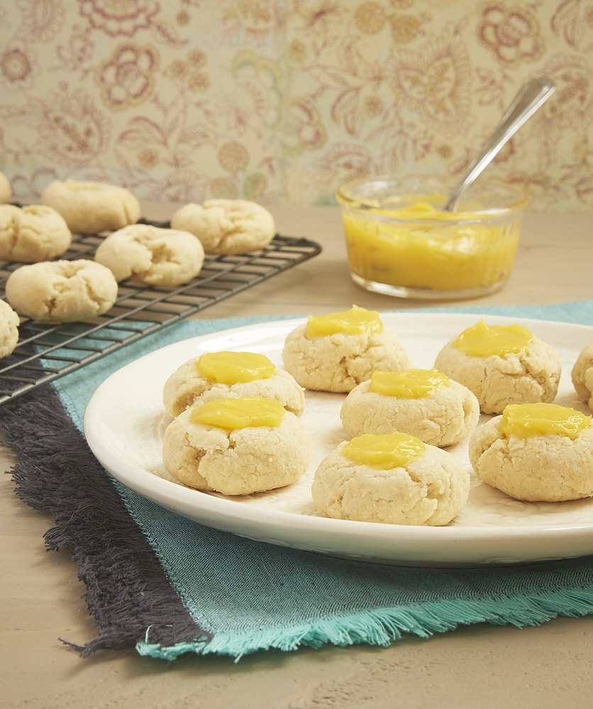 Sweet, tart lemon curd adds a delicious bite to these Lemon Thumbprint Cookies from Bake or Break.