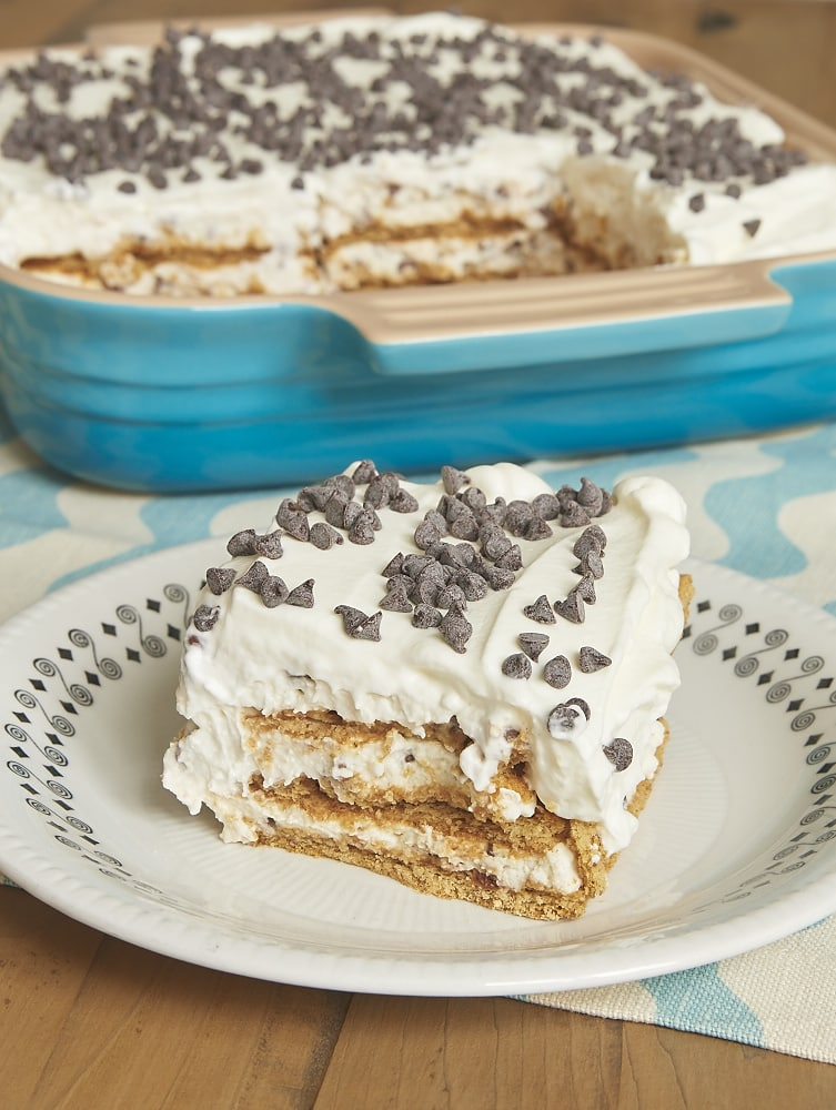 Cannoli Icebox Cake celebrates the flavors of cannoli with a lightly sweet filling, chocolate chips, and graham crackers. A breeze to make! - Bake or Break