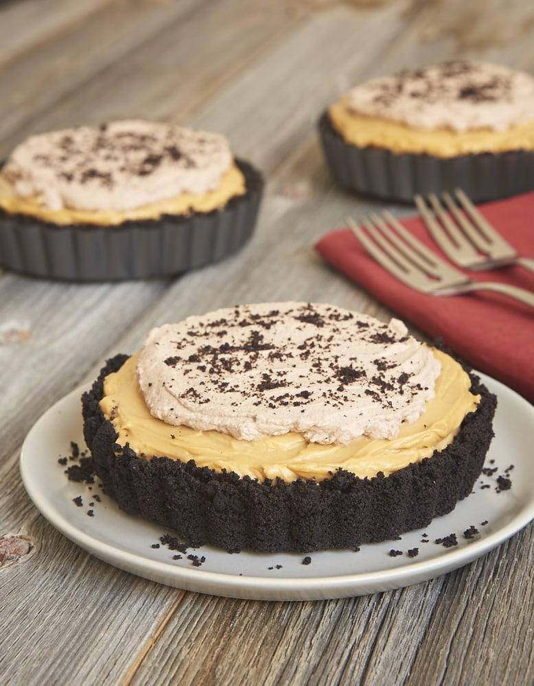 Dulce de leche, chocolate, and cheesecake are a tasty trio in this Dulce de Leche No-Bake Cheesecake! - Bake or Break