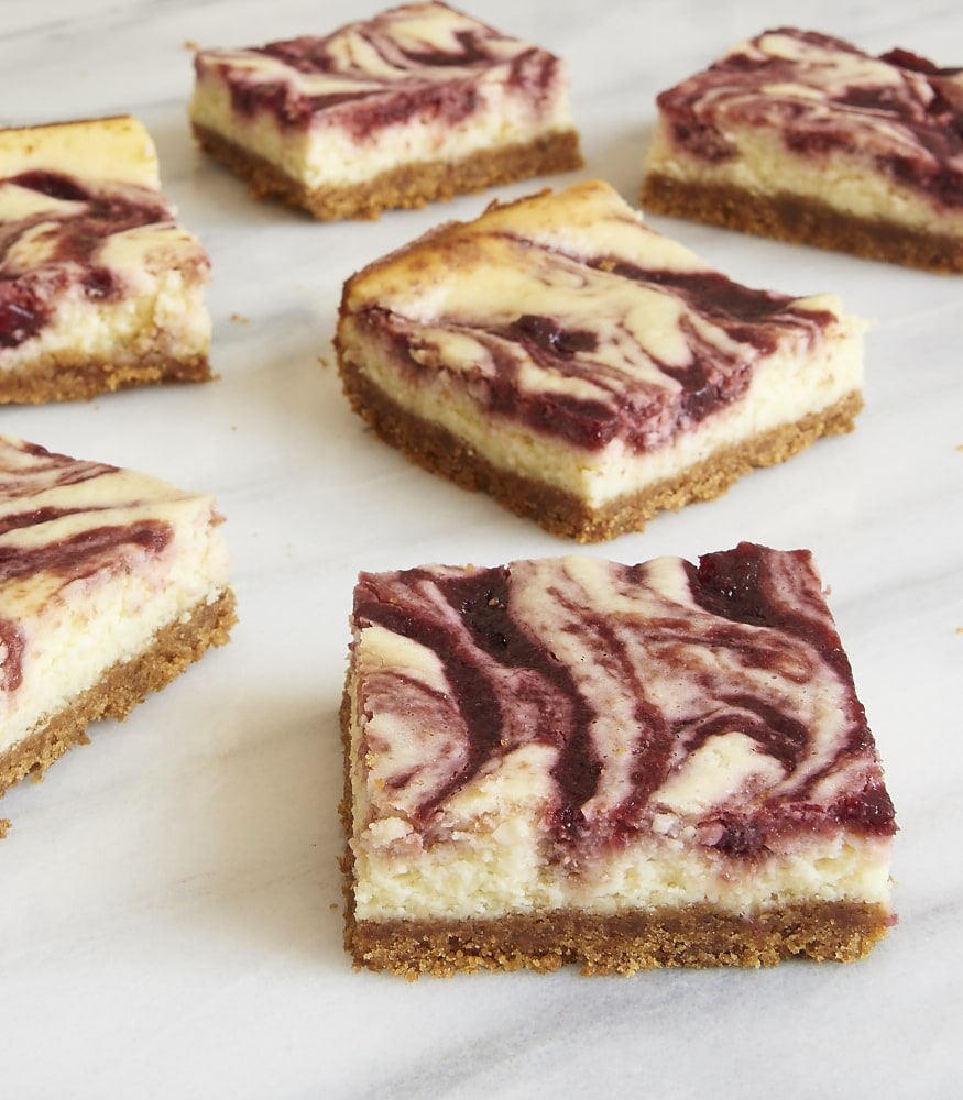 Rich cheesecake gets swirled with sweet cherries in these Cherry Cheesecake Bars. A delightful way to enjoy a classic flavor combination! - Bake or Break
