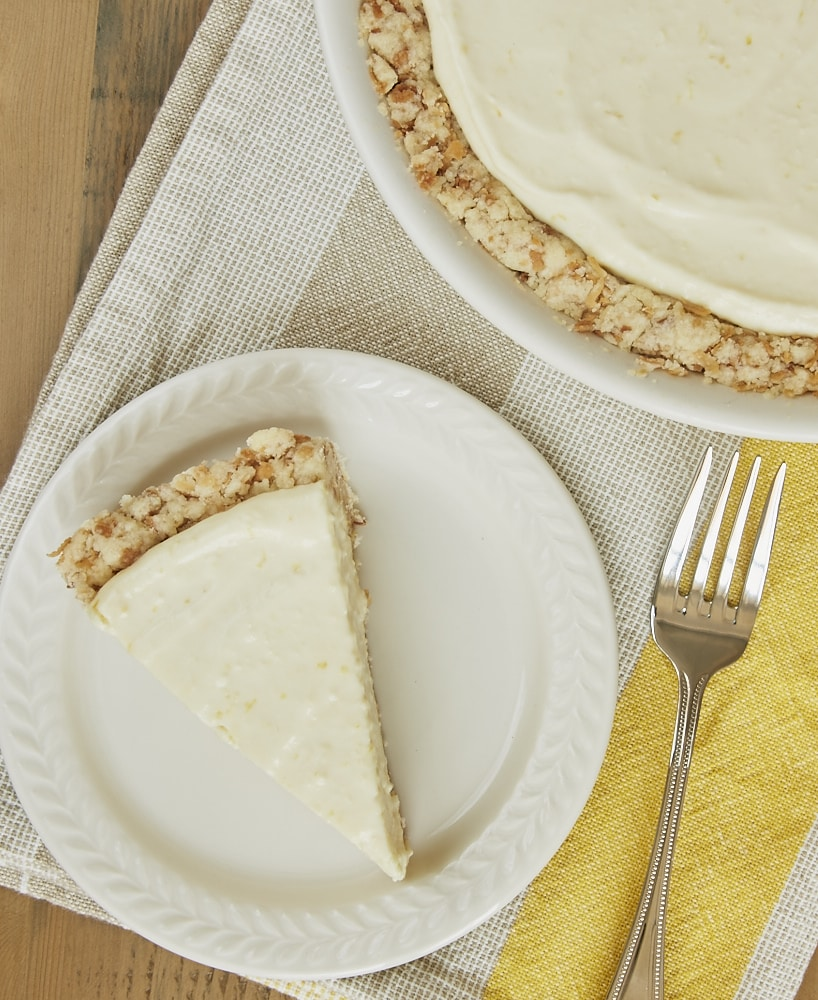 A sweet, tart, creamy lemon filling combines with a buttery coconut crust for a delicious twist on Lemon Icebox Pie! - Bake or Break