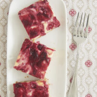 Cranberries and white chocolate are perfect complements in these irresistible Cranberry White Chocolate Cheesecake Bars! - Bake or Break