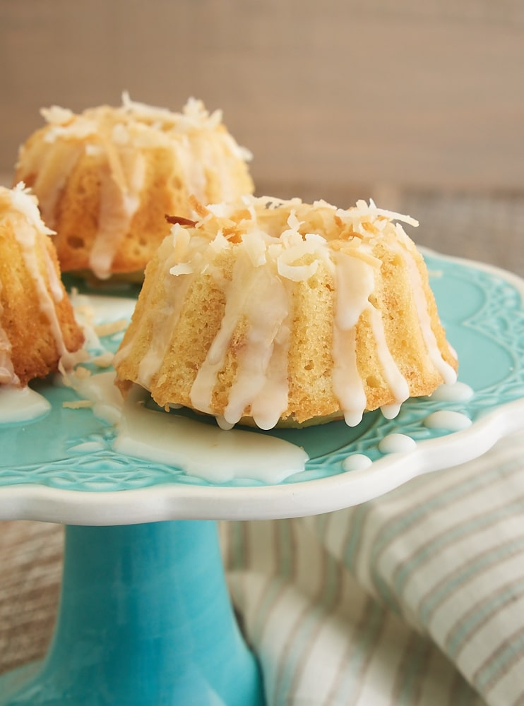 Toasted coconut adds big flavor to these Mini Coconut Bundt Cakes! - Bake or Break