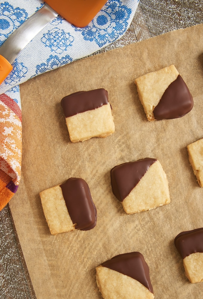 These quick and easy Chocolate-Dipped Hazelnut Shortbread are so addicting! The nutty, delicate shortbread combine perfectly with a bit of dark chocolate. - Bake or Break