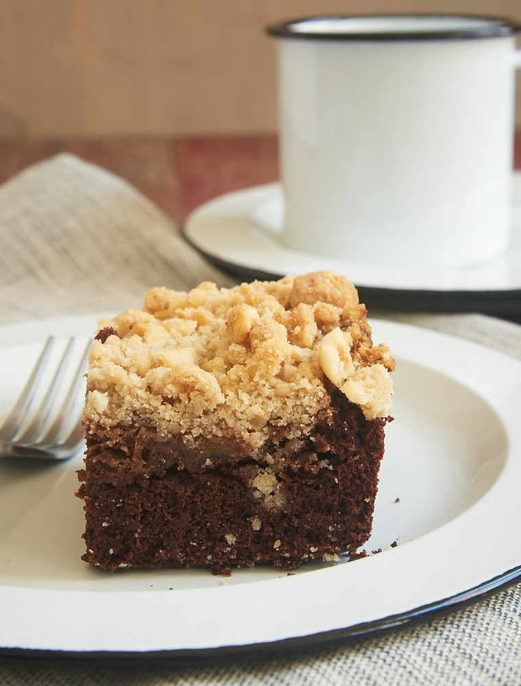 Chocolate cake, sweet cream cheese, and a nutty crumb topping combine to make this fantastic Chocolate Cream Cheese Coffee Cake! - Bake or Break