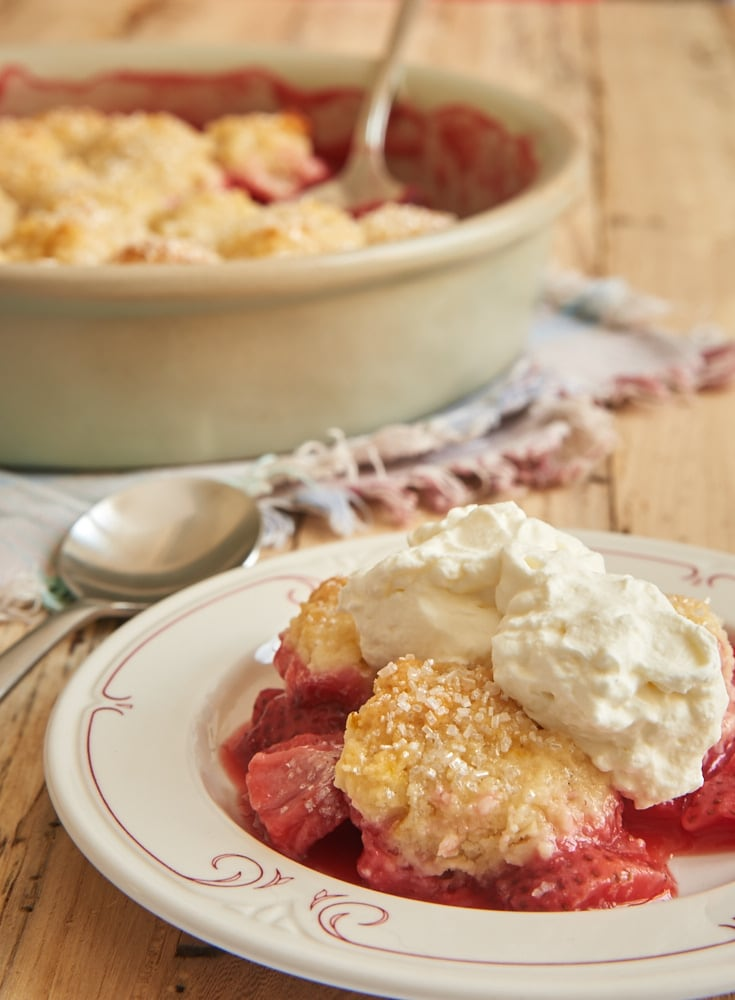 This Strawberry Cobbler is full of sweet berries along with a good dose of lemon. And it is all topped with sweet cream cheese biscuits! - Bake or Break