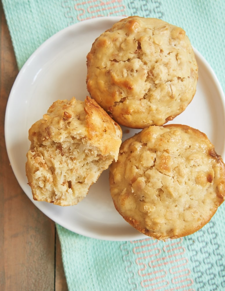 Toasted coconut adds lots of flavor to these sweet, hearty Coconut Cream Cheese Oat Muffins. - Bake or Break