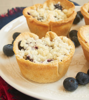Skip the slicing and serving with Mini Blueberry Cream Cheese Pies. Love that cream cheese surprise inside! - Bake or Break