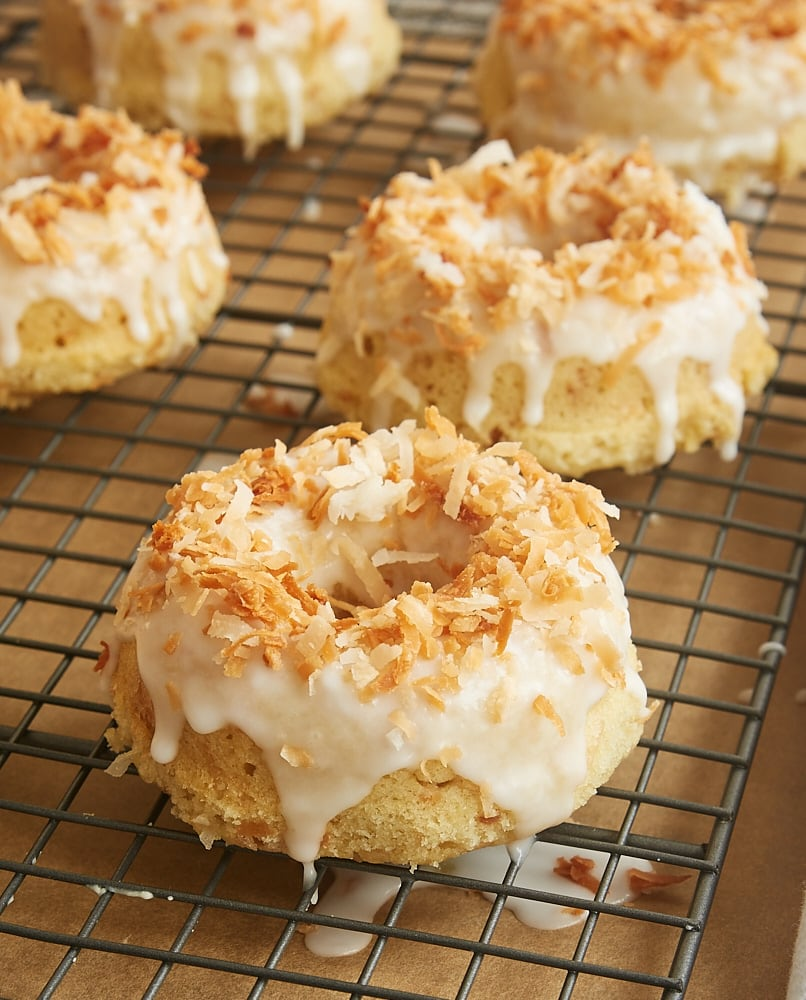 Coconut fans will devour these Toasted Coconut Cake Doughnuts. These are beyond outstanding! - Bake or Break