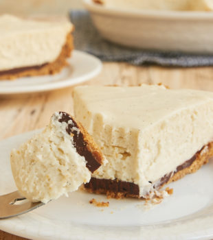 Black Bottom Vanilla Bean Cheesecake is a celebration of vanilla with a little chocolate surprise. This is one delicious dessert! - Bake or Break