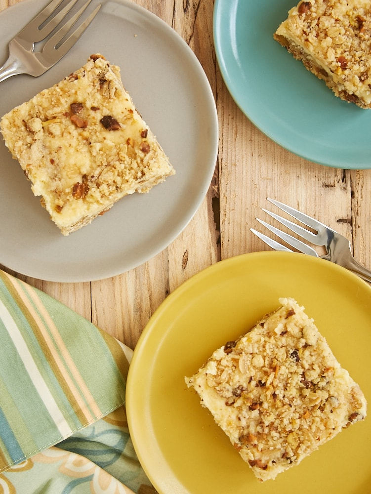 Lemon Pistachio Cheesecake Bars are a sweet, tart, nutty treat. The combination of lemons and pistachios is irresistible! - Bake or Break