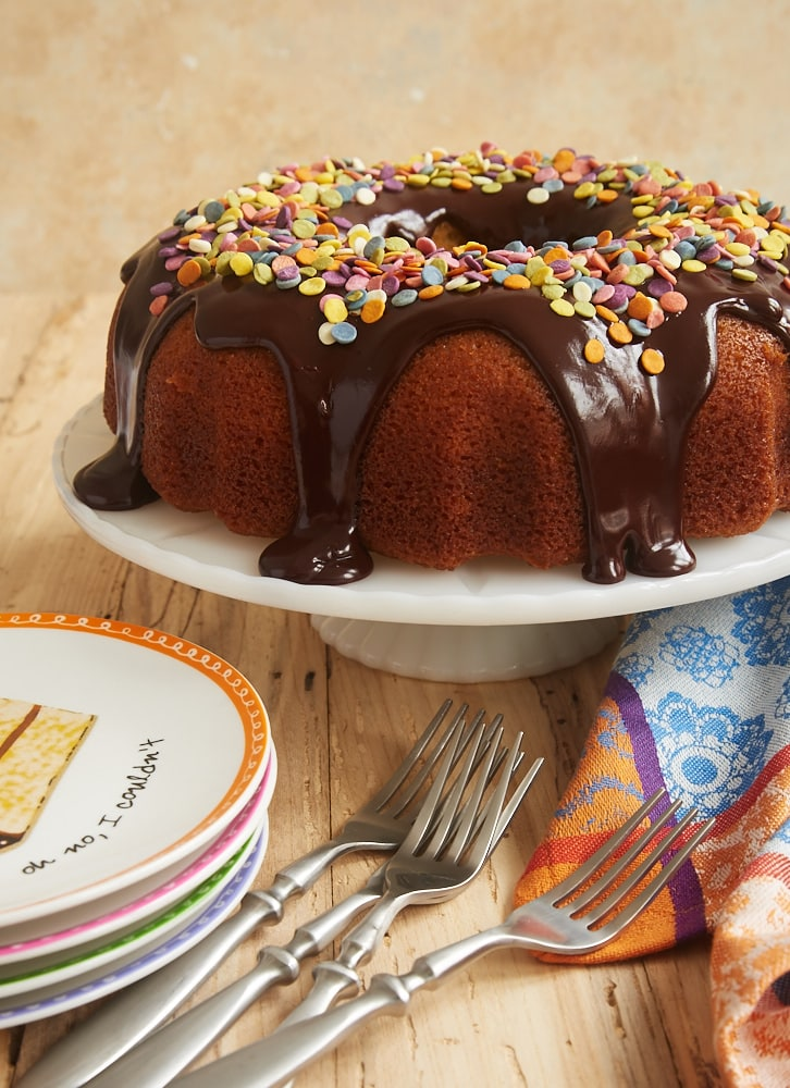 Yellow Bundt Cake with Dark Chocolate Ganache is one of my favorite celebration cakes, thanks to its crowd-pleasing flavors and ease of preparation. Just add sprinkles! - Bake or Break