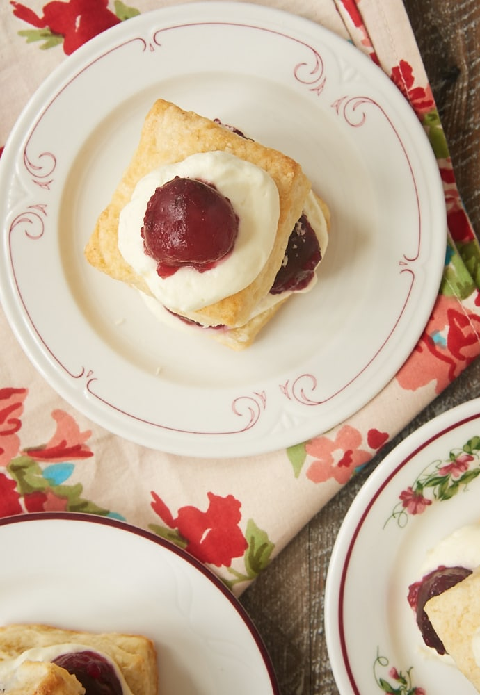 Sweet cherries, fluffy biscuits, and whipped cream combine for these delightful Cherry Shortcakes with Cream Cheese Biscuits. A summertime must! - Bake or Break