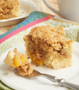 Sweet peaches, a crumb topping, and an irresistible cake make for one fantastic Peach Cobbler Coffee Cake! - Bake or Break