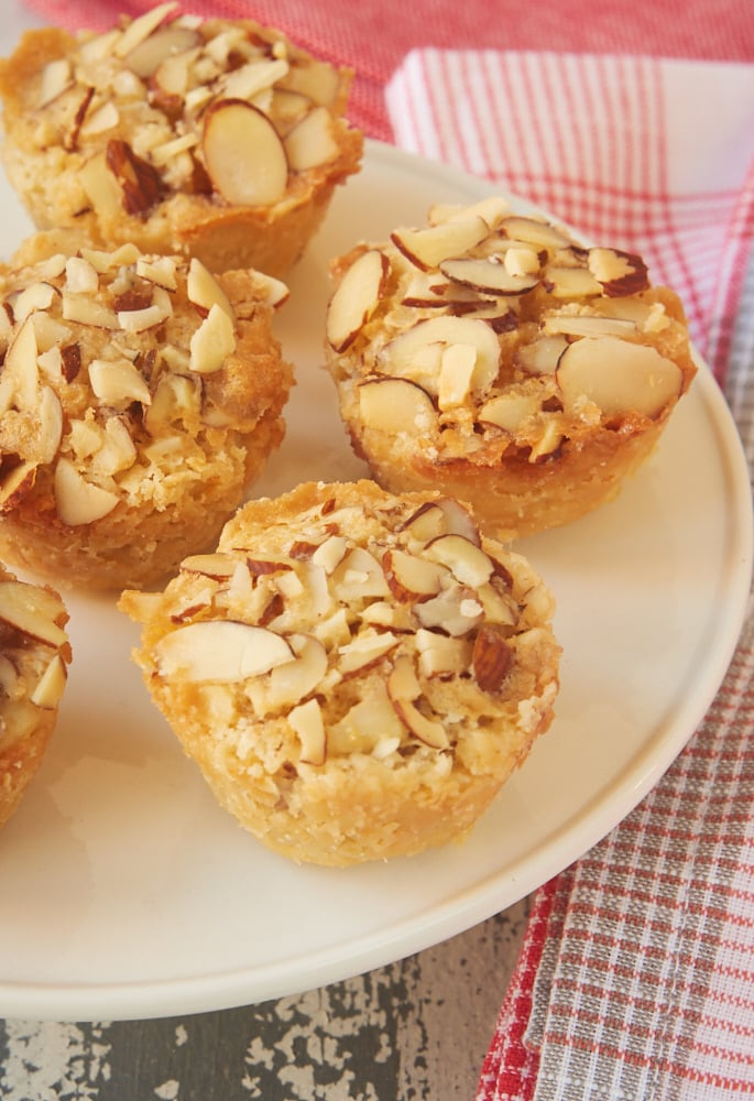 Raspberry Almond Tarts are simple bite-size tarts made with raspberry preserves and almond paste. Such a great flavor combination! - Bake or Break